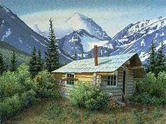 log cabin; mountains in back