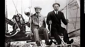 Orville, Wilber Wright in their airplane