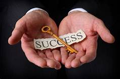"Two hands holding key; word ""success"""
