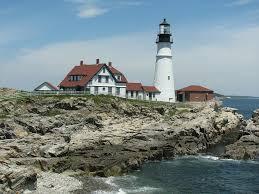 lighthouse & house on rocky point