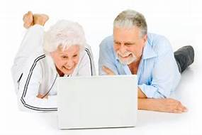 2 older people studying computer