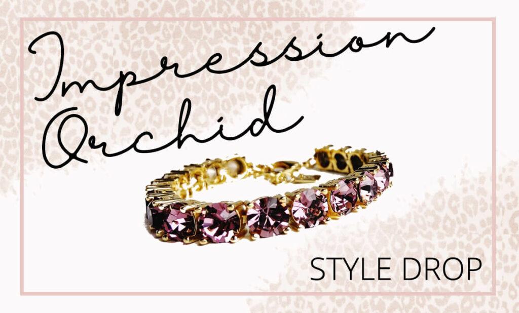 gold-colored bracelet; purple stones