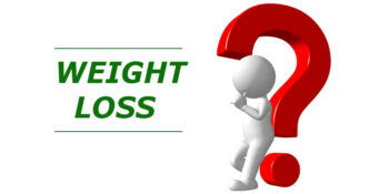 weight loss; questionmark with white doll leaning on it