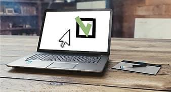 Computer; big checkmark on screen